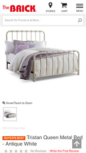 Metal king size bed frame, with low profile box spring.