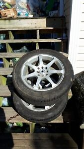Rims and tires for sale.