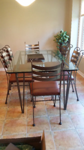 Custom made wrought iron & glass table with 6 chairs