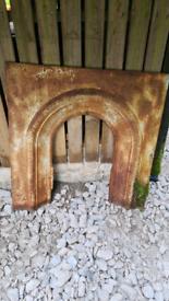 Antique cast iron fire inset