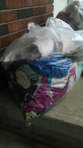 Two bags of diapes and diaer covers