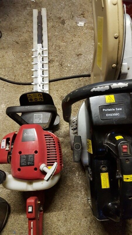 Masonry saw and petrol hedge trimmer