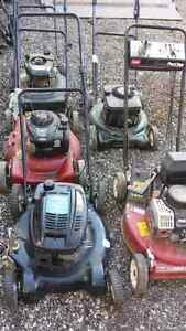 5 lawn mowers fixer uppers  all for $60