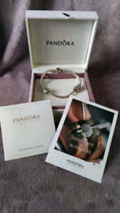 Authentic Pandora bracelet and 2 charms