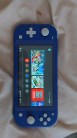 Nintendo switch lite blue with 64gb sd card
