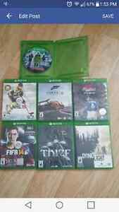Assorted video games n64 xbox one playstation 2 and nintendo wii
