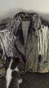 woman's jean jacket with fringes