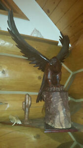 """THE EAGLE AS LANDED"" WOOD CARVING"