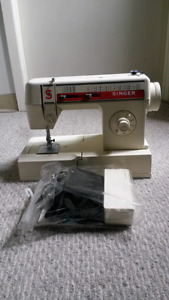Singer sewing machine and lots of thread