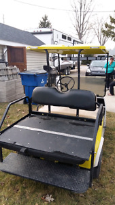 1988 Club Car. Electric. Charger included. Rear seat. windshield