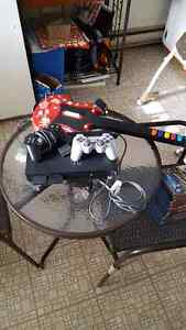 Playstation 2 + 3 controllers + 16 games