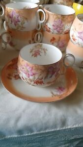Limoge dishes with lilies on it