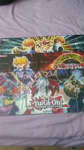 Yugioh duel mats rule books and tins