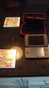 New Nintendo 3DS XL noir avec fil pour chargeur, étui et 2 jeux