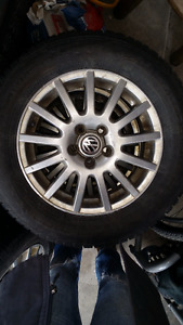 Four V.W. Golf alloy rims, 5x100, with Nokian 195/65 R15