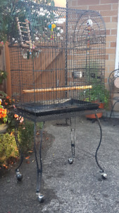 Bird cage on wheeled stand.