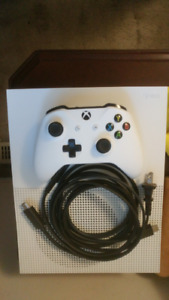 Xbox One S with Assassins Creed Origins on console