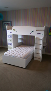 Loft Bunk bed with built in desk and shelving from Ashley