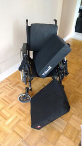 Manual wheelchair with additional seat