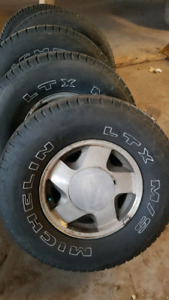Four Michelin M&S tires on 1988 to 1998 chev 6 bolt rims LT 265/