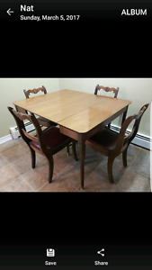 Antique kitchen table with 4 leaves.