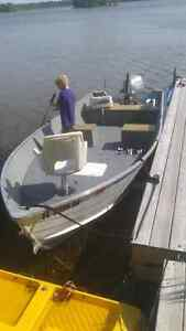 16 ft aluminum boat 20 hp 4 stroke Honda and trailer.