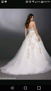 DaVinci wedding dress never worn.  Need gone ASAP.