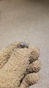 21k White Gold Solitaire Diamond Ring.