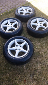 Set of 4 tires on Alloy Rims