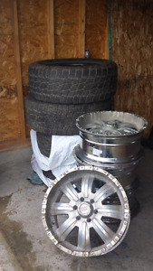 """4 - 20"""" Rims and 5 - 33x12.5x20  Tires for Sale"""