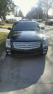 CADILLAC STS TRES PROPRE
