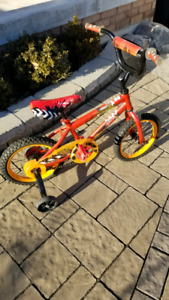 """Kids Huffy """"Lightening McQueen"""" bicycle with training wheels"""