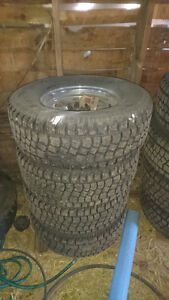 265/70R15 Hercules Avalanche studded snow tires on rims