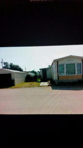 Mobile home situated in Prairie Oasis Trailer Court, Moose Jaw.