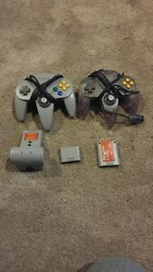 NINTENDO 64 CONTROLLERS AND 2 MEMORY CARD AND TRANSFER PAC