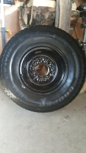 """OFFERS on two studded 14"""" winter tires on rims"""