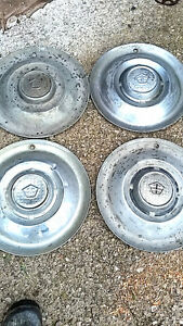 set of 4 old steel hub caps