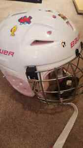 Girls hockey helmet comes with various stickers