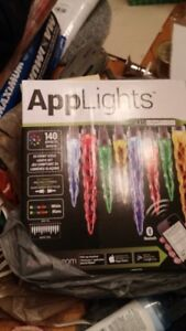 2 sets icicle applights.  New, never used Christmas lights