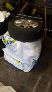 FOUR TIRES WITH RIMS FOR SALE