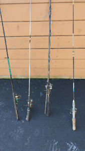 4 fishing poles and reels