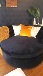 Round cuddle couch newly reupholstered.