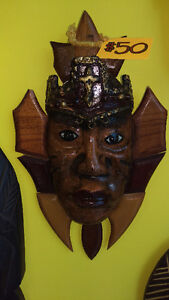 Shiny Crowned Wood Statue