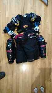 Assorted QUALITY hockey gear-skates, shin pads, pants,elbow pads