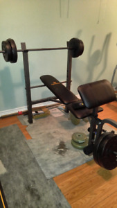 weight bench with 100 pounds of weights