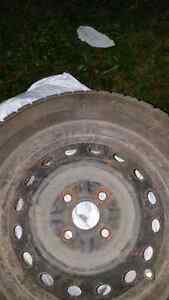"4 bolt 14"" winter tires on rims set of 4"