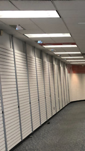 Store slot wall with designer mounting brackets