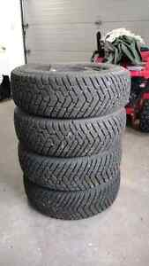 """4  215/70/15"""" Goodyear Snow tires and rims!"""