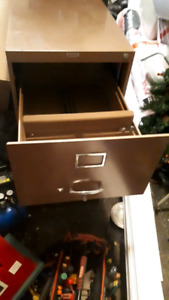 """2 filing Cabinets. 1Brown,1Grey. 2Brown,28""""L,18""""W,42""""H. 3drs. 1G"""