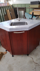 Cherry wood with marble tops cupboards $200 or trade